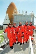 KENNEDY SPACE CENTER, Fla. -- The STS-104 crew poses for a group photo on the 215-foot level of the Fixed Service Structure. Standing left to right are Mission Specialist Janet Lynn Kavandi, Commander Steven Lindsey, Pilot Charles O. Hobaugh, and Mission Specialists Michael L. Gernhardt and James F. Reilly. The crew has been taking part in Terminal Countdown Demonstration Test activities, which include emergency egress training and a simulated countdown exercise. The launch of Atlantis on mission STS-104 is scheduled July 12. The mission is the 10th flight to the International Space Station and carries the Joint Airlock Module and High Pressure Gas Assembly