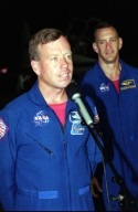 KENNEDY SPACE CENTER, Fla. -- After arriving at the Shuttle Landing Facility, the STS-104 crew stopped to talk to the media. At the microphone is Commander Steven W. Lindsey; at right is Pilot Charles O. Hobaugh. The crew is at KSC to make final preparations for their launch. Other crew members are Mission Specialists James F. Reilly, Janet Lynn Kavandi and Michael L. Gernhardt. The launch of Atlantis on mission STS-104 is scheduled for July 12 from Launch Pad 39B. The mission is the 10th assembly flight to the International Space Station and carries the Joint Airlock Module, which will become the primary path for spacewalk entry and departure using both U.S. spacesuits and the Russian Orlan spacesuit for EVA activity