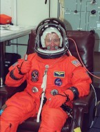 KENNEDY SPACE CENTER, Fla. -- Expedition Three Commander Frank Culbertson happily sits through suit fit check as part of Terminal Countdown Demonstration Test activities. He and fellow crew members Vladimir Nikolaevich Dezhurov and Mikhail Tyurin, both with the Russian Aviation and Space Agency, are taking part in the TCDT along with the STS-105 crew: Commander Scott Horowitz, Pilot Rick Sturckow, and Mission Specialists Daniel Barry and Patrick Forrester. The TCDT also includes emergency egress training and a simulated launch countdown. Mission STS-105 will be transporting the Expedition Three crew, several payloads and scientific experiments to the International Space Station aboard Space Shuttle Discovery. The current Expedition Two crew members on the Station will return to Earth on Discovery. Launch of Discovery is scheduled no earlier than Aug. 9, 2001