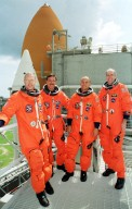 KENNEDY SPACE CENTER, Fla. -- The STS-105 crew poses on the Fixed Service Structure at Launch Pad 39A. From left are Mission Specialist Patrick Forrester, Commander Scott Horowitz, Pilot Rick Sturckow and Mission Specialist Dan Barry. The STS-105 and Expedition Three crews are at Kennedy Space Center participating in a Terminal Countdown Demonstration Test, a dress rehearsal for launch. The activities include emergency egress training, a simulated launch countdown and familiarization with the payload. Mission STS-105 will be transporting the Expedition Three crew, several payloads and scientific experiments to the International Space Station aboard Space Shuttle Discovery. The Expedition Two crew members currently on the Station will return to Earth on Discovery. The mission is scheduled to launch no earlier than Aug. 9, 2001