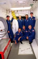 KENNEDY SPACE CENTER, Fla. -- The STS-105 and Expedition Three crews pose in the White Room on Launch Pad 39A. Standing are (left to right) Pilot Rick Sturckow, Mission Specialist Patrick Forrester, Commander Scott Horowitz and Mission Specialist Daniel Barry. Kneeling are cosmonaut Mikhail Tyurin, Commander Frank Culbertson and cosmonaut Vladimir Nikolaevich Dezhurov. Tyurin and Dezhurov are with the Russian Aviation and Space Agency. Both crews are at KSC to take part in Terminal Countdown Demonstration Test activities, which include emergency egress, a simulated launch countdown and familiarization with the payload. Mission STS-105 will be transporting the Expedition Three crew, several payloads and scientific experiments to the International Space Station aboard Discovery. The current Expedition Two crew members on the Station will return to Earth on Discovery. Launch of Discovery is scheduled no earlier than Aug. 9, 2001