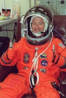KENNEDY SPACE CENTER, Fla. -- During pre-launch preparations, Expedition Three Commander Frank Culbertson shows his eagerness for liftoff. On the mission, Discovery will be transporting the Expedition Three crew and several scientific experiments and payloads to the ISS, including the Early Ammonia Servicer (EAS) tank. The EAS, which will support the thermal control subsystems until a permanent system is activated, will be attached to the Station during two spacewalks. The three-member Expedition Two crew will be returning to Earth aboard Discovery after a five-month stay on the Station. Launch is scheduled for 5:38 p.m. EDT Aug. 9
