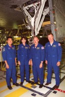 KENNEDY SPACE CENTER, Fla. -- The STS-108 crew pauses for a photo during Crew Equipment Interface Test activities at KSC. From left are Mission Specialists Daniel M. Tani and Linda A. Godwin; Pilot Mark E. Kelly; and Commander Dominic L. Gorie. The CEIT provides familiarization with the launch vehicle and payload. Mission STS-108 is a Utilization Flight (UF-1), carrying the Expedition Four crew plus Multi-Purpose Logistics Module Raffaello to the International Space Station. The Expedition Four crew comprises Yuri Onufriyenko, commander, Russian Aviation and Space Agency, and astronauts Daniel W. Bursch and Carl E. Walz. Endeavour is scheduled to launch Nov. 29 on mission STS-108