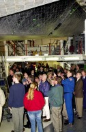 KENNEDY SPACE CENTER, FLA. -- In the Orbiter Processing Facility, former President Jimmy Carter (center) gets a closeup view of the underside of an orbiter space vehicle. On the outer edge of the crowd are (left to riht) Launch Director Mike Leinbach (green jacket), Space Shuttle Launch Integration Manager Jim Halsell and Center Director Roy D. Bridges. Carter and former First Lady Rosalyn Carter are touring KSC