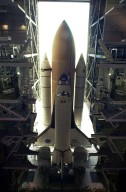 KENNEDY SPACE CENTER, FLA. -- Space Shuttle Columbia sits atop its Mobile Launcher Platform in the open doorway of the Vehicle Assembly Building. The Shuttle never left the VAB due to a steering problem on the crawler-transporter under the MLP. The problem was a faulty bearing in the steering linkage of Power Truck Drive D, which was detected before the C-T left the VAB. Rollout has been rescheduled for Jan. 24