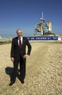 KENNEDY SPACE CENTER, Fla. - The new NASA Administrator Sean O'Keefe poses for the photographer near Launch Pad 39A. Space Shuttle Columbia is poised on the pad behind him for launch Feb. 28 and mission STS-109. The administrator was at KSC on an agencywide familiarization tour of NASA field centers. He was nominated for the position as administrator in November 2001 by President George W. Bush. He was sworn in Dec. 21 as the agency's 10th chief