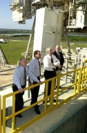 KENNEDY SPACE CENTER, Fla. - At Launch Pad 39A, (from left) Center Director Roy Bridges Jr., Shuttle Processing Director Dave King and the new NASA Administrator Sean O'Keefe look over Space Shuttle Columbia, scheduled to launch Feb. 28 on mission STS-109. The administrator was at KSC on an agencywide familiarization tour of NASA field centers. He was nominated for the position as administrator in November 2001 by President George W. Bush. He was sworn in Dec. 21 as the agency's 10th chief