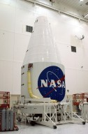 KENNEDY SPACE CENTER, FLA. - The fully encapsulated Tracking and Data Relay Satellite-I (TDRS-I) waits in the Spacecraft Assembly and Encapsulation Facility-2 (SAEF-2) for transfer to Cape Canaveral Air Force Station. The second in a new series of telemetry satellites, TDRS-I replenishes the existing on-orbit fleet of six spacecraft. The TDRS System is the primary source of space-to-ground voice, data and telemetry for the Space Shuttle. It also provides communications with the International Space Station and scientific spacecraft in low-Earth orbit such as the Hubble Space Telescope. This new advanced series of satellites will extend the availability of TDRS communications services until about 2017. Launch of TDRS-I is scheduled for March 8 aboard a Lockheed Martin Atlas IIA rocket from Pad 36-A