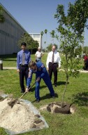 KENNEDY SPACE CENTER, FLA. -- Astronaut Frank Culbertson digs into the pile of dirt to plant the cherry laurel tree (right) near KSC Headquarters Building. The tree commemorates his stay on and safe return from the International Space Station as a member of the Expedition 3 crew. Culbertson served as commander for the four-month stay, August to December 2001. The tree planting is a tradition for the Expedition crews.