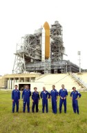 """KENNEDY SPACE CENTER, FLA. -- During a break in Terminal Countdown Demonstration Test activities, the STS-111 and Expedition 5 crews gather on Launch Pad 39A for a photo. Standing, left to right, are Expedition 5 crew members Sergei Treschev, Commander Valeri Korzun and Peggy Whitson; STS-111 Commander Kenneth Cockrell, Pilot Paul Lockhart, Mission Specialists Philippe Perrin and Franklin Chang-Diaz. Perrin is with the CNES, the French Space Agency. Expedition 5 will travel to the International Space Station on the mission as the replacement crew for Expedition 4, who will return to Earth aboard the orbiter Endeavour. The crews are taking part in Terminal Countdown Demonstration Test activities at the pad, which include emergency egress training and a simulated launch countdown. The mission is Utilization Flight 2, carrying supplies and equipment to the International Space Station, the Mobile Base System, which will be installed on the Mobile Transporter to complete the Canadian Mobile Servicing System, or MSS, and a replacement wrist/roll joint for Canadarm 2. The mechanical arm will then have the capability to """"inchworm"""" from the U.S. Lab Destiny to the MSS and travel along the truss to work sites. Launch is scheduled for May 30, 2002"""