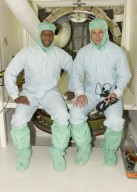 KENNEDY SPACE CENTER, FLA. -- Dressed in bunny suits, STS-107 Payload Commander Michael Anderson (left) and 107 Payload Specialist Ilan Ramon, with the Israeli Space Agency, are ready to enter Columbia's payload bay to work on Fast Reaction Experiments Enabling Science, Technology, Applications and Research (FREESTAR) experiments for the mission. FREESTAR comprises Mediterranean Israeli Dust, Solar Constant, Shuttle Ozone Limb Sounding, Critical Viscosity of Xenon, Low Power, and Space Experimental Module experiments. Another payload is the SHI Research Double Module (SHI/RDM), also known as SPACEHAB. The experiments range from material sciences to life sciences. STS-107 is scheduled to launch July 11, 2002