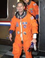 KENNEDY SPACE CENTER, FLA. - STS-111 Pilot Paul Lockhart steps down from the Astrovan outside the crew quarters at the Operations and Checkout Building after returning from Space Shuttle Endeavour at Launch Pad 39A. The launch of STS-111 was scrubbed due to poor weather at KSC. STS-111 is the second Utilization Flight to the International Space Station, carrying the Multi-Purpose Logistics Module Leonardo, the Mobile Base System (MBS), and a replacement wrist/roll joint for the Canadarm 2. Also on board will be the Expedition Five crew who will replace Expedition Four on the Station. Launch is rescheduled for May 31 at 7:22 p.m. EDT