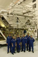 KENNEDY SPACE CENTER, FLA. -- The STS-112 crew gathers in front of structures in the Space Station Processing Facility where they have been looking over part of the payload as part of the Crew Equipment Interface Test activities. From left are Commander Jeffrey Ashby, Pilot Pamela Melroy and Mission Specialists Sandra Magnus, David Wolf, Piers Sellers and Fyodor Yurchikhin, who is with the Russian Space Agency. The S1 truss is the first starboard (right-side) truss segment for the International Space Station, whose main job is providing structural support for the orbiting research facility's radiator panels that cool the Station's complex power system. The S1 truss segment also will house communications systems, external experiment positions and other subsystems. The S1 truss will be attached to the S0 truss. Launch of STS-112 is scheduled for Aug. 22, 2002