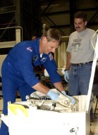 KENNEDY SPACE CENTER, FLA. - STS-112 Mission Specialist Piers Sellers checks out flight equipment during a Crew Equipment Interface Test at KSC. STS-112 is the 15th assembly flight to the International Space Station and will be ferrying the S1 Integrated Truss Structure. The S1 truss is the first starboard (right-side) truss segment, whose main job is providing structural support for the radiator panels that cool the Space Station's complex power system. The S1 truss segment also will house communications systems, external experiment positions and other subsystems. The S1 truss will be attached to the S0 truss. STS-112 is currently scheduled for launch Aug. 22, 2002