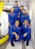 KENNEDY SPACE CENTER, FLA. -- The STS-112 crew pauses for a photo in the White Room during Terminal Countdown Demonstration Test activities. Kneeling in front are Mission Specialists Piers Sellers and David Wolf; standing, left to right, are Mission Specialist Sandra Magnus, Pilot Pamela Melroy, Commander Jeffrey Ashby and Mission Specialist Fyodor Yurchikhin. (with the Russian Space Agency). Mission STS-112 aboard Space Shuttle Atlantis is scheduled to launch no earlier than Oct. 2, between 2 and 6 p.m. EDT. STS-112 is the 15th assembly mission to the International Space Station. Atlantis will be carrying the S1 Integrated Truss Structure, the first starboard truss segment, to be attached to the central truss segment, S0, and the Crew and Equipment Translation Aid (CETA) Cart A. The CETA is the first of two human-powered carts that will ride along the ISS railway, providing mobile work platforms for future spacewalking astronauts.