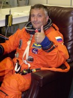 KENNEDY SPACE CENTER, FLA. -- During suitup for launch, STS-112 Mission Specialist Fyodor Yurchikhin shows he is ready for his first Shuttle flight. STS-112 is the 15th assembly flight to the International Space Station, carrying the S1 Integrated Truss Structure, the first starboard truss segment, to be attached to the central truss segment, S0, and the Crew and Equipment Translation Aid (CETA) Cart A. The CETA is the first of two human-powered carts that will ride along the ISS railway, providing mobile work platforms for future spacewalking astronauts. On the 11-day mission, three spacewalks are planned to attach the S1 truss. Launch is scheduled for 3:46 p.m. EDT from Launch Pad 39B.