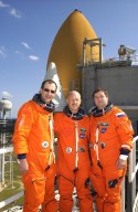 KENNEDY SPACE CENTER, FLA. - The Expedition 6 crew poses for a photo on 195-foot level of the Fixed Service Structure on Launch Pad 39A. From left are astronaut Donald Pettit, Commander Ken Bowersox and cosmonaut Nikolai Budarin. Along with the STS-113 crew, they have been participating in emergency egress training, part of Terminal Countdown Demonstration Test activities in preparation for their launch. The 16th assembly flight to the International Space Station, STS-113 will carry the Port 1 (P1) truss aboard Space Shuttle Endeavour, as well as Expedition 6, who will replace Expedition 5 on the Station. The mission is scheduled to launch Nov. 10, 2002.