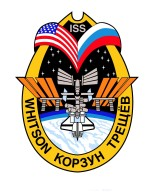 JOHNSON SPACE CENTER, HOUSTON, TEXAS -- EXPEDITION FIVE CREW INSIGNIA (ISS05-S-001) -- The International Space Station (ISS) Expedition Five patch depicts the Station in its completed configuration and represents the vision of mankind's first step as a permanent human presence in space. The United States and Russian flags are joined together in a Roman numeral V to represent both the nationalities of the crew and the fifth crew to live aboard the ISS. Crew members' names are shown in the border of this patch. This increment encompasses a new phase in growth for the Station, with three Shuttle crews delivering critical components and building blocks to the ISS. To signify the participation of each crew member, the Shuttle is docked to the Station beneath a constellation of 17 stars symbolizing all those visiting and living aboard Station during this increment. The NASA insignia design for Shuttle flights is reserved for use by the astronauts and for other official use as the NASA Administrator may authorize. Public availability has been approved only in the forms of illustrations by the various news media. When and if there is any change in this policy, which is not anticipated, the change will be publicly announced.
