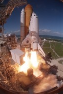 KENNEDY SPACE CENTER, FLA. - A fish eye view captures the liftoff of Space Shuttle Atlantis from Launch Pad 39B. At left is the Fixed Service Structure and below the Shuttle is the Mobile Launcher Platform. In the background is the Atlantic Ocean. Liftoff of Atlantis on mission STS-110 occurred at 4:44:19 p.m. EDT (20:41:19 GMT). Carrying the S0 Integrated Truss Structure and Mobile Transporter, STS-110 is the 13th assembly flight to the International Space Station