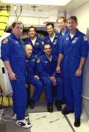 KENNEDY SPACE CENTER, FLA. -- At the entrance to Space Shuttle Endeavour's cockpit, the STS-113 and Expedition 6 crews gather for a photo during Terminal Countdown Demonstration Test activities at the pad. From left, in front, are cosmonaut Nikolai Budarin, Commander Ken Bowersox and astronaut Donald Pettit of Expedition 6, and STS-113 Pilot Paul Lockhart. In back, from left, are STS-113 Mission Specialists John Herrington and Michael Lopez-Alegria and Commander James Wetherbee. The TCDT also includes a simulated launch countdown. The 16th assembly flight to the International Space Station, STS-113 will carry the Port 1 (P1) truss aboard Space Shuttle Endeavour as well as the Expedition 6 crew, who will replace Expedition 5 on the Station. Mission STS-113 is scheduled to launch Nov. 10, 2002.