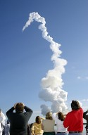 KENNEDY SPACE CENTER, FLA. -- After a perfect launch, spectators try to catch a last glimpse of Space Shuttle Columbia, barely visible at the top end of the twisted column of smoke. Following a flawless and uneventful countdown, liftoff occurred on-time at 10:39 a.m. EST. Headed for a 16-day research mission, Columbia's crew will be taking part in more than 80 experiment, including FREESTAR (Fast Reaction Experiments Enabling Science, Technology, Applications and Research) and the SHI Research Double Module (SHI/RDM), known as SPACEHAB. Experiments on the module range from material sciences to life sciences. This mission is the first Shuttle mission of 2003. Mission STS-107 is the 28th flight of the orbiter Columbia and the 113th flight overall in NASA's Space Shuttle program.