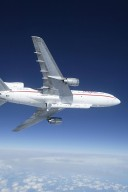 KENNEDY SPACE CENTER, FLA. - The L-1011 aircraft soars through the sky over the Atlantic Ocean with a Pegasus XL rocket, containing NASA's Solar Radiation and Climate Experiment (SORCE), attached underneath. The rocket will be dropped from the aircraft at 3:14 p.m. EST. Over the next few days, the mission team will insure that the spacecraft is functioning properly. The SORCE science instruments will then be turned on and their health verified. Approximately 21 days after launch, if all is going well, the instruments will start initial science data collection and calibration will begin. The spacecraft will study the Sun's influence on our Earth and will measure from space how the Sun affects the Earth's ozone layer, atmospheric circulation, clouds, and oceans. This mission is a joint partnership between NASA and the University of Colorado's Laboratory for Atmospheric and Space Physics in Boulder, Colorado. [Photo courtesy of Jeff Caplan, Langley Research]