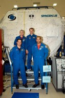 KENNEDY SPACE CENTER, FLA. -- The STS-116 crew poses outside the SPACEHAB module during training. In the rear are Commander Terrence Wilcutt and Mission Specialist Christer Fuglesang;; in front are Pilot William Oefelein and Mission Specialist Robert Curbeam. Objective of their mission to the International Space Station is to deliver and attach the third port truss segment, the P5 Truss, deactivate and retract the P6 Truss Channel 4B (port-side) solar array, and reconfigure station power from 2A and 4A solar arrays. A launch date is under review.