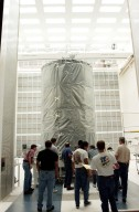 KENNEDY SPACE CENTER, FLA. - At Cape Canaveral Air Force Station, the Space Infrared Telescope Facility (SIRTF) observatory is moved into NASA Spacecraft Hangar AE. SIRTF will remain in the clean room at Hangar AE until it returns to the pad in early August.