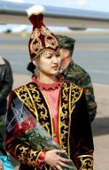 ASTANA, KAZAKHSTAN - One of three local Kazakh girls who were on hand at the Astana airport to welcome the Expedition Six crew with roses after the crew landed on the Kazakh Steppe in their Soyuz capsule. The Expedition Six crew spent 161 days in space, 159 manning the International Space Station. Photo Credit: NASA/Bill Ingalls