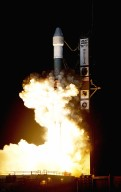 KENNEDY SPACE CENTER, FLA. - NASA launches its second Mars Exploration Rover, Opportunity, aboard a Delta II launch vehicle. The bright glare briefly illuminated Florida Space Coast beaches. Opportunity?s dash to Mars began with liftoff at 11:18:15 p.m. Eastern Daylight Time from Cape Canaveral Air Force Station, Fla. The spacecraft separated successfully from the Delta's third stage 83 minutes later, after it had been boosted out of Earth orbit and onto a course toward Mars. [Photo courtesy of Ray Yost and Scott Andrews/NIKON]