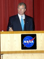 KENNEDY SPACE CENTER, FLA. -- U.S. Rep. Tom Feeney addresses employees in a Town Hall meeting at KSC with comments on the new mission for NASA outlined by President George W. Bush Jan. 14. He shared the stage with U.S. Rep. Dave Weldon and Center Director Jim Kennedy. All three later answered questions from employees in the audience.