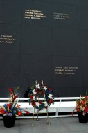 KENNEDY SPACE CENTER, FLA. - A wreath and other floral arrangements rest beneath the Astronaut Memorial Mirror at the KSC Visitor Complex following a memorial service held for the crew of Columbia on the anniversary of the tragic accident that took their lives Feb. 1, 2003. The black granite mirror honors astronauts, whose names are carved in the surface, who have given their lives for space exploration. The service included comments by Center Director Jim Kennedy, Deputy Director Woodrow Whitlow Jr., Executive Director of Florida Space Authority Winston Scott, and Dr. Stephen Feldman, president of the Astronaut Memorial Foundation, who placed the wreath at the mirror.