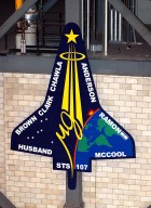 KENNEDY SPACE CENTER, FLA. - A 20-foot by 15-foot replica of the STS-107 logo has been installed above the ?A? on the A tower in the transfer aisle of the Vehicle Assembly Building. The debris from the orbiter Columbia, lost in a tragic accident on its return to Earth from the STS-107 mission, is permanently stored in the tower. A dedication ceremony Jan. 29, 2004, unveiled a plaque being installed in the storage area in honor of ?Columbia, the crew of STS-107, and their loved ones.?