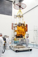 KENNEDY SPACE CENTER, FLA. - At the Astrotech Space Operations processing facilities, NASA?s MESSENGER spacecraft is lifted off the pallet for transfer to a work stand. There employees of the Johns Hopkins University Applied Physics Laboratory, builders of the spacecraft, will perform an initial state-of-health check. Then processing for launch can begin, including checkout of the power systems, communications systems and control systems. The thermal blankets will also be attached for flight. MESSENGER - short for MErcury Surface, Space ENvironment, GEochemistry and Ranging - will be launched May 11 on a six-year mission aboard a Boeing Delta II rocket. Liftoff is targeted for 2:26 a.m. EDT on Tuesday, May 11.