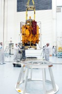 KENNEDY SPACE CENTER, FLA. - At the Astrotech Space Operations processing facilities, an overhead crane moves NASA?s MESSENGER spacecraft toward a work stand. There employees of the Johns Hopkins University Applied Physics Laboratory, builders of the spacecraft, will perform an initial state-of-health check. Then processing for launch can begin, including checkout of the power systems, communications systems and control systems. The thermal blankets will also be attached for flight. MESSENGER - short for MErcury Surface, Space ENvironment, GEochemistry and Ranging - will be launched May 11 on a six-year mission aboard a Boeing Delta II rocket. Liftoff is targeted for 2:26 a.m. EDT on Tuesday, May 11.