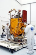 KENNEDY SPACE CENTER, FLA. - In the high bay clean room at the Astrotech Space Operations processing facilities near KSC, NASA?s MESSENGER spacecraft is revealed. Employees of the Johns Hopkins University Applied Physics Laboratory, builders of the spacecraft, will perform an initial state-of-health check. Then processing for launch can begin, including checkout of the power systems, communications systems and control systems. The thermal blankets will also be attached for flight. MESSENGER - short for MErcury Surface, Space ENvironment, GEochemistry and Ranging - will be launched May 11 on a six-year mission aboard a Boeing Delta II rocket. Liftoff is targeted for 2:26 a.m. EDT on Tuesday, May 11.