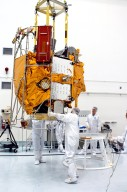 KENNEDY SPACE CENTER, FLA. - At the Astrotech Space Operations processing facilities, an overhead crane lowers NASA?s MESSENGER spacecraft onto a work stand. There employees of the Johns Hopkins University Applied Physics Laboratory, builders of the spacecraft, will perform an initial state-of-health check. Then processing for launch can begin, including checkout of the power systems, communications systems and control systems. The thermal blankets will also be attached for flight. MESSENGER - short for MErcury Surface, Space ENvironment, GEochemistry and Ranging - will be launched May 11 on a six-year mission aboard a Boeing Delta II rocket. Liftoff is targeted for 2:26 a.m. EDT on Tuesday, May 11.