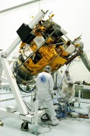 KENNEDY SPACE CENTER, FLA. -- Astrotech Space Operations facilities near KSC, workers begin to rotate the Mercury Surface, Space Environment, Geochemistry and Ranging (MESSENGER) spacecraft on the turnover fixture. Workers will perform the propulsion system phasing test - firing gas through the thrusters in order to verify that the right thrusters fire when expected - as part of prelaunch testing at the site. Launch is scheduled for May 11 from Pad 17-B, Cape Canaveral Air Force Station. The spacecraft will fly past Venus three times and Mercury twice before starting a year-long orbital study of Mercury in July 2009.