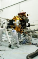 KENNEDY SPACE CENTER, FLA. -- - Astrotech Space Operations facilities near KSC, workers check the Mercury Surface, Space Environment, Geochemistry and Ranging (MESSENGER) spacecraft as it rotates on the turnover fixture. Workers will perform the propulsion system phasing test - firing gas through the thrusters in order to verify that the right thrusters fire when expected - as part of prelaunch testing at the site. Launch is scheduled for May 11 from Pad 17-B, Cape Canaveral Air Force Station. The spacecraft will fly past Venus three times and Mercury twice before starting a year-long orbital study of Mercury in July 2009.
