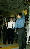 KENNEDY SPACE CENTER, FLA. -- On a tour of the Orbiter Processing Facility, Florida Gov. Jeb Bush (center) and his wife, Columba (left), listen to NASA Vehicle Manager Scott Thurston talk about the orbiter Atlantis overhead. The tour followed the launching ceremony at the KSC Visitor Complex for the new Florida quarter issued by the U.S. Mint. The ceremony was emceed by Center Director Jim Kennedy and included remarks by NASA Administrator Sean O?Keefe, Bush, U.S. Mint Director Henrietta Holsman Fore and Deputy Secretary of the Treasury Samuel W. Bodman.