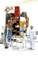 KENNEDY SPACE CENTER, FLA. - - A technician at Astrotech Space Operations in Titusville, Fla., checks the MESSENGER (Mercury Surface, Space Environment, Geochemistry and Ranging) spacecraft after its move to a stand inside the nonhazardous payload processing facility. Final assembly and testing will be completed at this site. The spacecraft will return to the hazardous processing facility when ready for fueling, spin balance testing and mating to the upper stage. MESSENGER is scheduled to launch no earlier than July 30 from Cape Canaveral Air Force Station. MESSENGER is a scientific investigation of the planet Mercury, the least explored terrestrial planet. Understanding Mercury and how it was formed is essential to understanding the other terrestrial planets and their evolution. The MESSENGER mission will orbit Mercury after making two flybys of the planet, using data collected during the flybys as an initial guide to perform a more focused scientific investigation of this mysterious world. The spacecraft will enter Mercury orbit in March 2011 and carry out comprehensive measurements for one full Earth year.