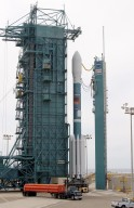 KENNEDY SPACE CENTER, FLA. -- The Mobile Service Tower rolls back to the Delta II carrying the Gravity Probe B spacecraft at Space Launch Complex 2 on Vandenberg AFB after first launch attempt was scrubbed.