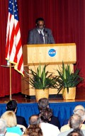 KENNEDY SPACE CENTER, FLA. -- Jim Jennings, Deputy Associate Administrator for Institutions and Asset Management addresses KSC employees assembled in the Training Auditorium for a Culture Change Process All Hands Meeting. The purpose of the meeting was for employees to gain further insight into the Agency?s Vision for Space Exploration and the direction cultural change will take at KSC in order to assume its role within this vision. Other participants included James W. Kennedy, KSC director; Lynn Cline, Deputy Associate Administrator for Space Flight; Bob Sieck, former Director of Space Shuttle Processing at KSC; and Jim Wetherbee, astronaut and Technical Assistant to the Director of Safety and Mission Assurance at Johnson Space Center. Following their remarks, members of the panel entertained questions and comments from the audience.
