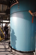 KENNEDY SPACE CENTER, FLA. - Inside the mobile service tower on Launch Pad 17-B, Cape Canaveral Air Force Station, Fla., Boeing workers aid in lowering the replacement interstage adapter toward the Boeing Delta II below. The rocket is the launch vehicle for the Deep Impact spacecraft. Boeing workers will attach the adapter to the rocket?s center body section. Later the second stage, which was removed to allow access to the previous adapter, will be reattached. The first adapter was removed after it was found to be faulty during a review of launch vehicle hardware. Launch of Deep Impact is now scheduled no earlier than Jan. 12.