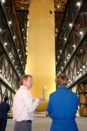 KENNEDY SPACE CENTER, FLA. - Shuttle Launch Director Mike Leinbach talks to STS-114 Mission Commander Eileen Collins as they watch the newly redesigned External Tank being lifted in the Vehicle Assembly Building to a ?checkout cell? where the tank?s mechanical, electrical and thermal protection systems are inspected. Collins and the rest of the crew are at Kennedy to observe tank activities. The tank will also undergo new processes resulting from its redesign, including inspection of the bipod heater and External Tank separation camera. The tank is designated to fly on Shuttle Discovery on Return to Flight mission STS-114. The launch window is May 12 to June 3, 2005.