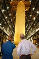 KENNEDY SPACE CENTER, FLA. - Mission STS-114 Commander Eileen Collins and Sen. Bill Nelson watch as the newly redesigned External Tank is lifted in the Vehicle Assembly Building to a ?checkout cell? where the tank?s mechanical, electrical and thermal protection systems are inspected. The mission crew and Nelson are at Kennedy to observe tank activities. The tank will also undergo new processes resulting from its redesign, including inspection of the bipod heater and External Tank separation camera. The tank is designated to fly with Shuttle Discovery on Return to Flight mission STS-114. The launch window is May 12 to June 3, 2005.