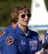 KENNEDY SPACE CENTER, FLA. - At the Shuttle Landing Facility, STS-114 Mission Commander Eileen Collins talks to reporters before she and the rest of the crew depart Kennedy Space Center. The crew was at KSC to observe the newly redesigned External Tank and new 50-foot-long Orbiter Boom Sensor System (OBSS). Among redesign changes on the ET is the forward bipod fitting to reduce the risk to the Shuttle from falling debris during ascent. A camera has also been added to capture separation of the ET from the Shuttle after launch. The OBSS attaches to the end of the Shuttle?s robotic arm and equips the orbiter with cameras and laser systems to inspect the Shuttle?s Thermal Protection System while in space. The launch window for Return to Flight mission STS-114 is May 12 to June 3, 2005. (Photo: Michael R. Brown)