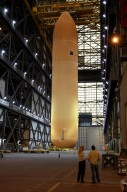 """KENNEDY SPACE CENTER, FLA. - In the Vehicle Assembly Building, the redesigned External Tank is being lifted into the """"checkout cell"""" where the tank?s mechanical, electrical and thermal protection systems are inspected. The tank will also undergo new processes resulting from its redesign, including inspection of the bipod heater and External Tank separation camera. The tank will be prepared for """"mating"""" to the Shuttle?s Solid Rocket Boosters. When preparations are complete, the tank will be lifted from the checkout cell, moved across the transfer aisle and into High Bay 1. It will be lowered and attached to the boosters, which are sitting on the Mobile Launch Platform. The SRBs and ET will be flying with Shuttle Discovery for the Return to Flight mission STS-114. The launch planning window is May 12 to June 3, 2005."""