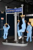 KENNEDY SPACE CENTER, FLA. - At the Museum of Science and Industry (MOSI) in Tampa, students from one of NASA?s Explorer Schools, Stewart Middle School in Tampa, enjoy an interactive exhibit. The students are at MOSI to view the space exhibit Space: A Journey to Our Future, an extraordinary, interactive exhibition designed to entertain, educate and inspire. Another exhibit is SPACE STATION, the first cinematic journey to the International Space Station (ISS), where audiences can experience for themselves life in zero gravity aboard the new station.