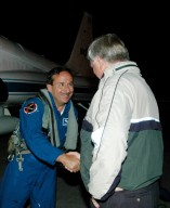 KENNEDY SPACE CENTER, FLA. - At Kennedy Space Center?s Shuttle Landing Facility, STS-114 Mission Specialist Charles Camarda (left) is greeted by Center Director Jim Kennedy. Camarda and other crew members are taking part in the Terminal Countdown Demonstration Test (TCDT) over the next three days. The TCDT is held at KSC prior to each Space Shuttle flight. It provides the crew of each mission an opportunity to participate in simulated countdown activities. The test ends with a mock launch countdown culminating in a simulated main engine cutoff. The crew also spends time undergoing emergency egress training exercises at the launch pad. This is Camarda?s first space flight. STS-114 is the first Return to Flight mission to the International Space Station. The launch window extends July 13 through July 31.